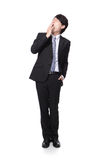Overworked business man yawning. In full body isolated on white background, model is a asian people Royalty Free Stock Photography