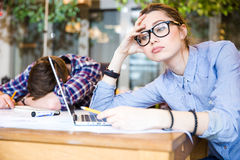 Overworked business people sitting and sleeping Stock Photography