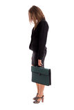 Overworked business woman carring her briefcase Stock Photos
