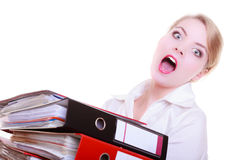 Overworked business woman with stack folder document screaming. Overworked busy businesswoman secretary with stack of folders documents screaming isolated on Royalty Free Stock Photos