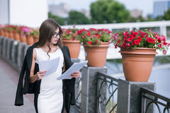 Overworked business woman on walk Royalty Free Stock Photography