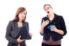 Overworked business women. Two tired overworked business women, isolated on white background Stock Image