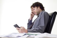 Overworked businessman. With pile of paperwork Royalty Free Stock Images