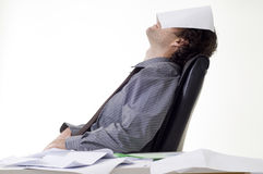 Overworked businessman. With pile of paperwork Royalty Free Stock Photography