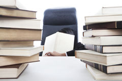 Overworked businessman. Sleeping in office while holding a book Royalty Free Stock Images