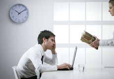 Overworked businessman. Tired businessman, with a too much paperwork and documents Stock Images