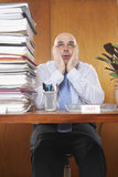 Overworked Businessman At Desk Stock Photos