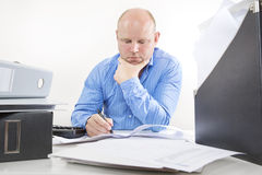 Overworked businessman at the office Royalty Free Stock Photos