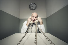 Overworked businessman on the phone Stock Photo