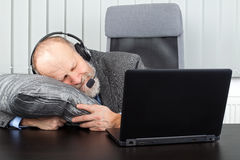 Overworked businessman. Picture of an overworked businessman sleeping at the office Royalty Free Stock Photos