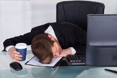 Overworked businessman resting on contract paper Stock Photo