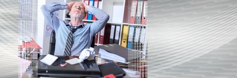 Overworked businessman sitting at a messy desk. panoramic banner. Overworked businessman sitting at a messy desk in office. panoramic banner stock image