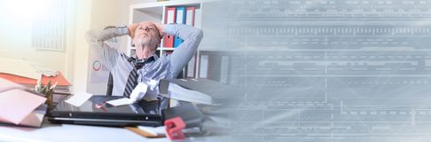 Overworked businessman sitting at a messy desk. panoramic banner. Overworked businessman sitting at a messy desk in office, light effect. panoramic banner royalty free stock images