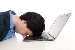 Overworked businessman sleeping on his laptop Royalty Free Stock Photography
