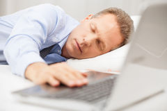 Overworked businessman sleeping. Stock Photos