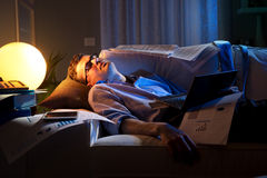 Overworked businessman on sofa Royalty Free Stock Photo