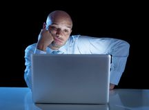 Overworked businessman working on computer laptop late night  exhausted Stock Photos