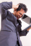Overworked businessman. Overworked young smart asian businessman Stock Image
