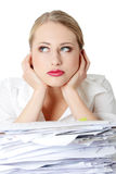 Overworked businesswoman. Isolated on white Stock Photo