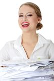 Overworked businesswoman. Overworked but happy businesswoman isolated on white Royalty Free Stock Images