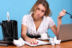 Overworked businesswoman. In the office workplace Stock Photo