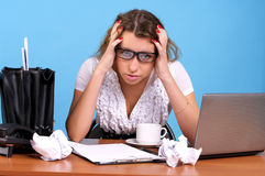 Overworked businesswoman. In the office workplace Stock Images