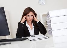 Overworked Businesswoman In Office Royalty Free Stock Image