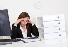 Overworked Businesswoman In Office Stock Images