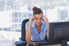 Overworked businesswoman. In the office Royalty Free Stock Images
