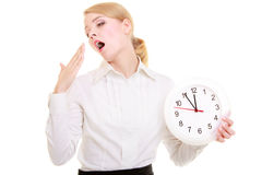 Overworked businesswoman showing clock yawning Stock Image