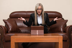 Overworked Businesswoman Sitting By Her Desk Stock Image