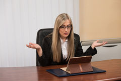 Overworked Businesswoman Sitting By Her Desk Royalty Free Stock Photo