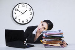 Overworked businesswoman take a rest. Portrait of overworked businesswoman take a rest on a pile of documents Royalty Free Stock Images