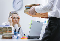 Overworked businesswoman. Tired businesswoman with a too much paperwork and documents Royalty Free Stock Photo
