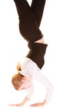 Overworked businesswoman walking on hands. Business. Overworked businesswoman walking on hands isolated on white. Busy woman upside down Stock Photos