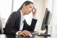 Overworked Businesswoman Working On Computer Royalty Free Stock Photo