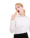 Overworked businesswoman yawning. Portrait of overworked businesswoman. Sleepy blond girl yawning isolated on white. Long working hours. Studio shot Royalty Free Stock Image
