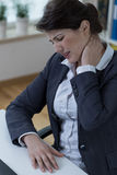 Overworked businesswomen suffer from pain Royalty Free Stock Photography