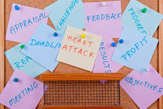 Overworked. Colorful corporate notes pinned to cork board Royalty Free Stock Photos