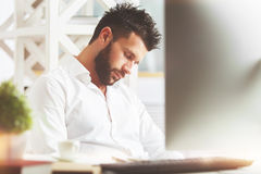 Overworked concept. Portrait of handsome caucasian guy sleeping at workplace. Overworked concept Royalty Free Stock Images