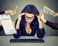 Overworked desperate woman leaning on a desk Royalty Free Stock Photography
