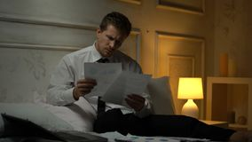 Overworked disappointed businessman finding failure in report suffering headache. Stock footage stock video footage