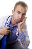 Overworked doctor. Portrait of an overworked and tired young doctor Stock Photos