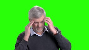 Overworked elderly enterpreneur having migraine. Tired mature man massaging his temples because of headache on Alpha Channel background. People and health care stock footage