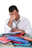 Overworked employee. A overworked employee feeling stressed Stock Images