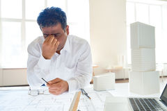 Overworked engineer Royalty Free Stock Photo