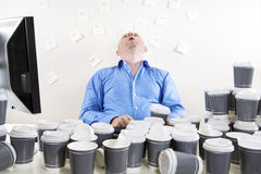 Overworked and exhausted office worker Royalty Free Stock Photos
