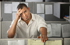 Overworked Male Office Worker Royalty Free Stock Images