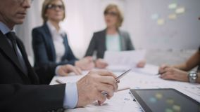 Overworked male office worker sighs at meeting, occupational burnout, stress. Stock footage stock video