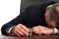 Overworked man in the office after alcohol Royalty Free Stock Photos